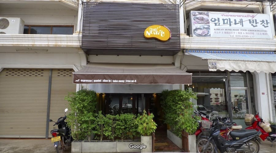 front of cafe nomad in vientiane